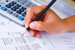 Hand checking financial report